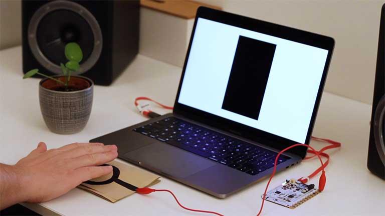 A student testing a proximity sensor.