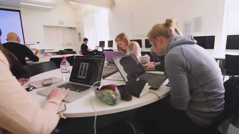 Students working in a Graphic Design studio.