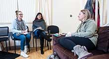 Three women talking.