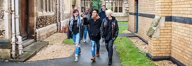 A group of sutdents walking through Francis Close Hall campus.